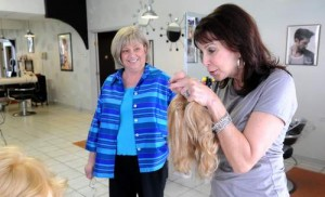 suntimes51421_2-Linda-Leinweber-owner-of-Shears-To-You-Salon-in-Oak-Lawn-talks-about-hair-replacement-options-with-client-Annette-Kalat.-Larry-RuehlSun-Times-Media-300x182